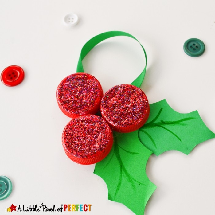 Milk Cap Holly Ornaments: An easy and inexpensive Christmas kids craft to decorate the tree with