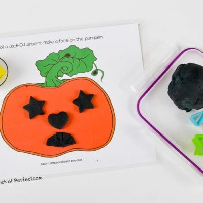 Roll a Jack O' Lantern Halloween Playdough Game for Kids (Free Printable)