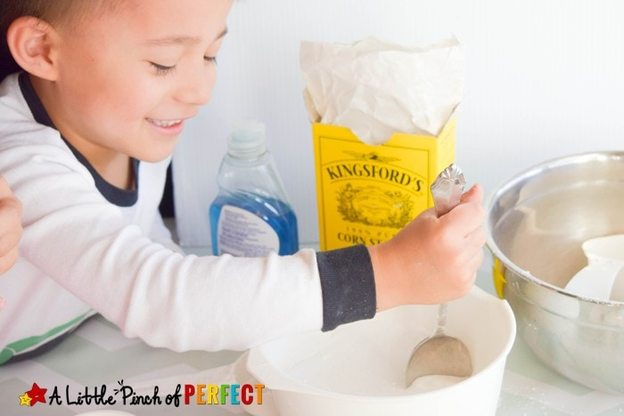 How to make Pretend Snow: Winter Themed Kinetic Sand Sensory Play for Kids that can be used to build snowmen, snow angels, and cool winter creations without getting cold. (December, January, Kids Activity)