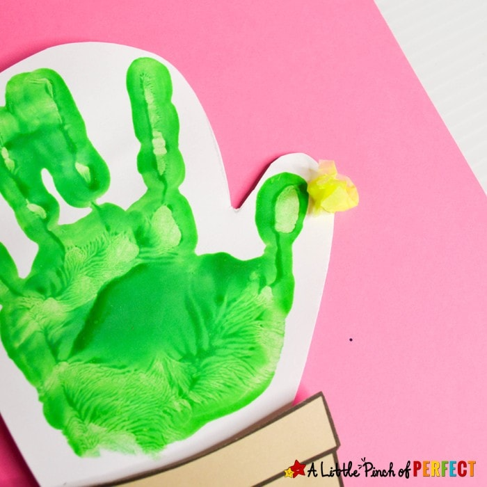 """Kids can make the cutest cactus Valentine's Day craft with our free craft template and their adorable little handprints The templates say """"Hug me"""" """"I'm Totally Stuck on You"""" """"I Love You!"""" and the fourth option has writing lines so kids can write their own message. This craft can be turned into a card. (#Valentines #kidscraft #handprint)"""