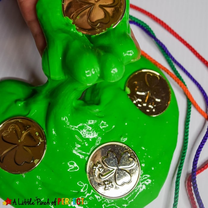 Learn how to make St. Patrick's Day fluffy slime with our favorite new slime recipe. It's easy to make and goes well with gold coins, rainbows, and leprechauns for St. Patrick's Day fun! #slime #kidsactivity #stpatricksday