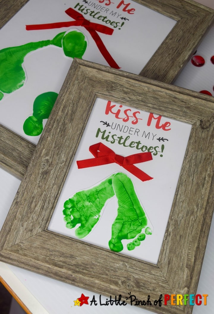 Kiss Me Under the Mistletoe Footprint Craft, Free Template, and Directions: This is so darling for Christmas. (#christmas #craft #kidsactivity #Preschool)