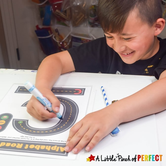 This amazing set of alphabet roads mats provides a fun way for children to learn write letters. They include a practice page, tracing lines, guiding arrows and stop signs, and phonics pictures for bonus learning. (#preschool, #kindergarten, #alphabet, #kidsactivities #homeschool #languagearts)