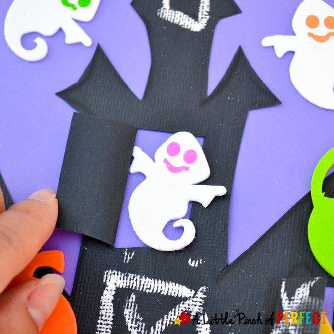 Make a spooky Haunted House craft with windows and doors that open and shut for Halloween friends to peek out of with our free craft template for kids. #craft #kidscraft #halloween #halloweencraft #crafttemplate