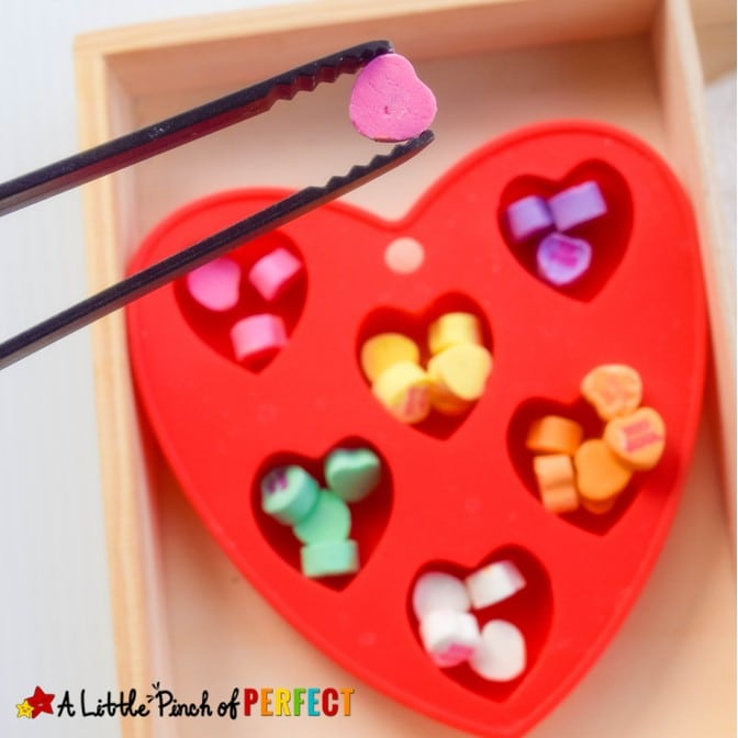 Valentine's Conversation Heart Sorting: Fine Motor Skills and Colors: Adapt this simple and fun activity for children so they can learn colors, counting, one-to-one correspondence and fine motor skills. #valentinesday #preschool #kindergarten #homeschool