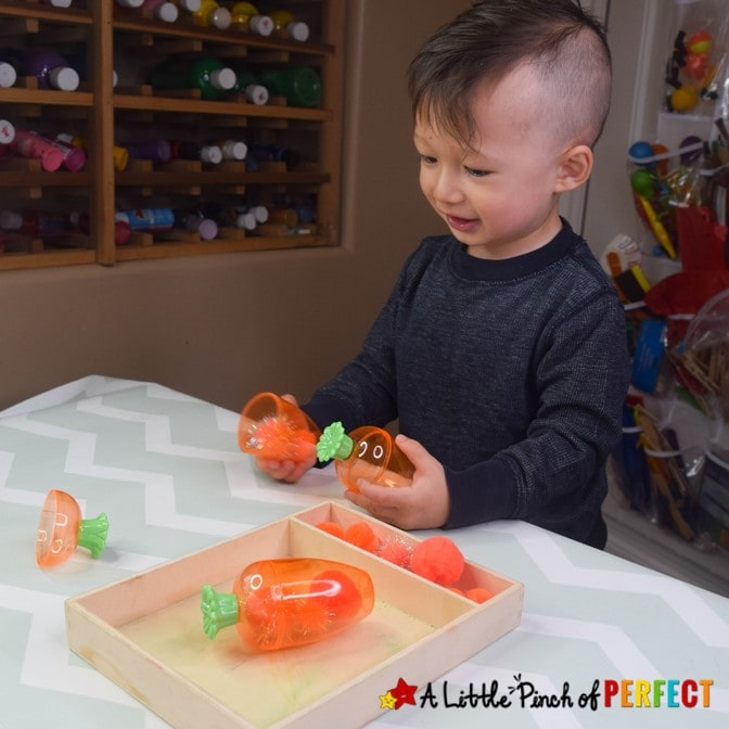 Kids will have so much fun with plastic carrots and puff balls! This engaging activity can be adapted for young children of all ages including ideas for your baby, toddler, and preschooler. #easter #kidsactivity #finemotor